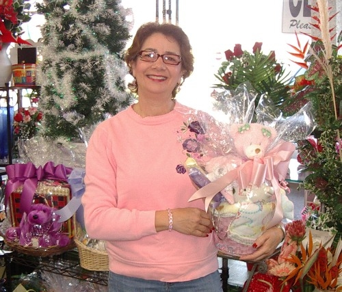 Tina holds a gift basket
