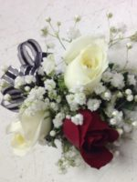 red and white corsage