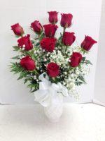 red roses white vase