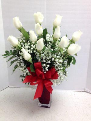 white roses red vase