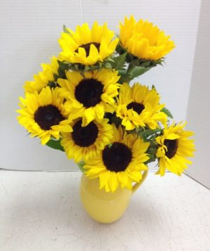 9 sunflowers in yellow vase