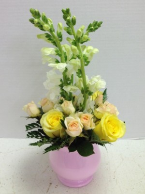 yellow and pink roses in pink vase