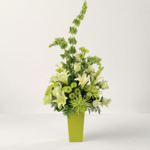 everyday green and yellow flowers in green vase