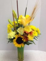 tall fall flower arrangement in tall vase