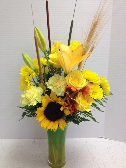 tall fall flower arrangement in tall vase