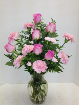 pink roses and carnations in glass vase