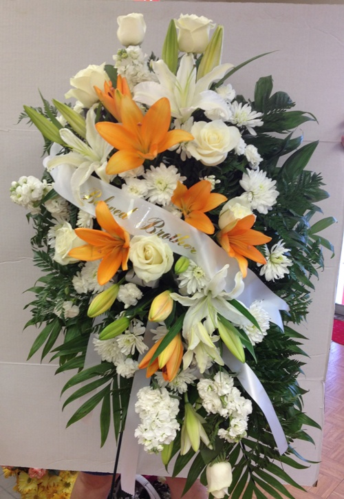 white spray with orange lilies