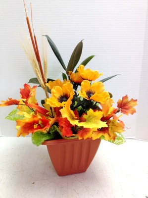 fall flower arrangement in orange pot