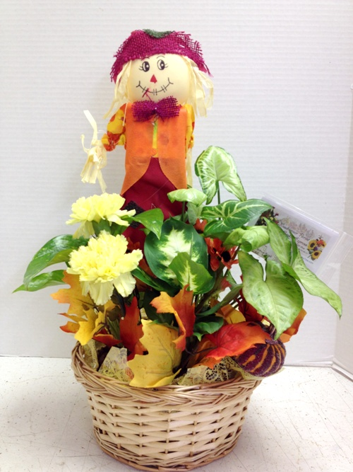 fall planter with scarecrow