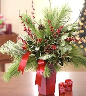 christmas red vase with greens