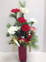 tall red vase flowers with snowman