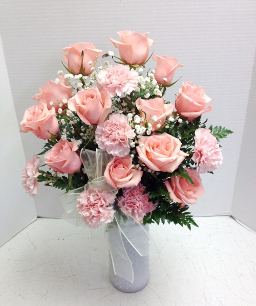 Pink Roses in tall white vase