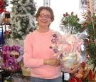 Tina holding a gift basket